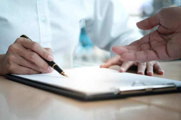 lawyer reviewing a form with a patient